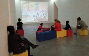 Visitors watch Gerald McBoing Boing at an Argentine UPA exhibit
